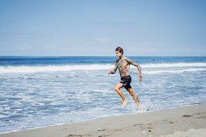 man on the ocean coast running