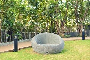 Relaxing Rattan Sofa in a garden, outdoor object