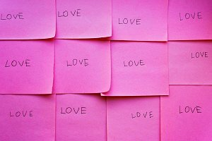 The word love on pink paper