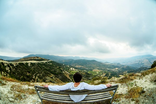 Nature Stock Photos: FotoMag - Man sitting on bench in mountains