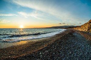 sea surface and sunny summer rocky coastline
