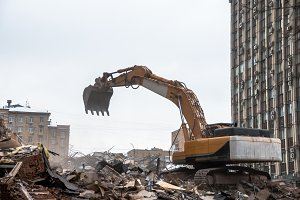 Hydraulic crusher excavator working on a demolition site