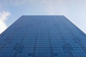 Facade of a building, blue sky, reflection
