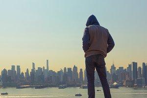 A Man Looking at New York City, USA