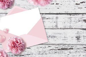 Paper in pink envelope and flowers