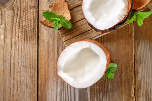 Coconut with mint on old wooden table. Organic healthy food concept.Beauty and SPA concept.