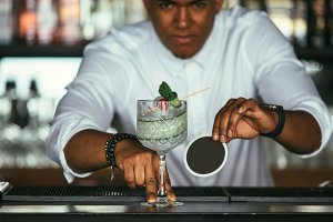 Cocktail served by a bartender