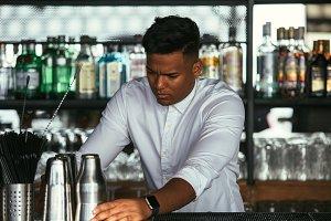 Bartender prepares cocktail