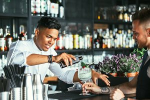 Bartender prepares a cocktail