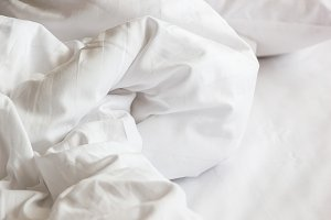 white pillow on bed