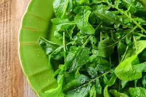 Fresh green home arugula leaves, rucola. Salad.