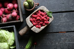 Healthy eating, food, dieting and vegetarian concept. Berries and vegetables on the table.