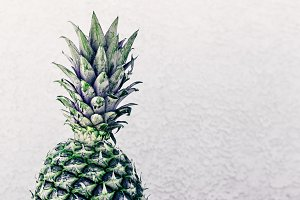 Closeup Of Pineapple Against A Wall