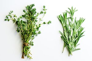 Bunches of tied thyme and rosemary