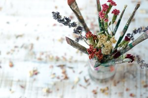 Paint Brushes and Dried Flowers