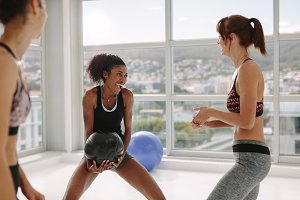 Medicine ball group exercise at gym