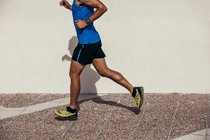 Athletic man jogging outdoors