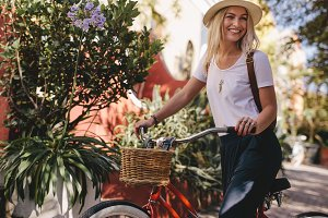 Beautiful woman riding her bike