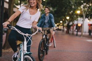 Woman enjoying cycling outdoors