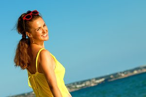smiling fit woman on beach in evening walking