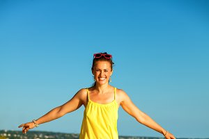 cheerful active woman on seashore in evening having fun time