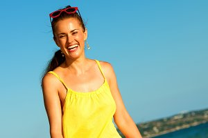 happy active woman on seashore in evening having fun time