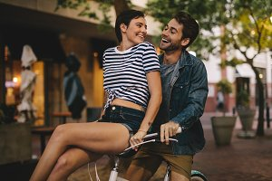 Loving couple riding on bike