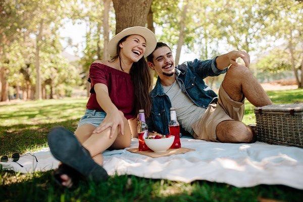 Cheerful couple having a picnic