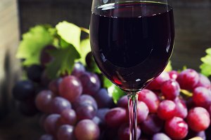 Wine and grape on wooden background