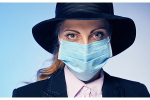 Young woman in a protective mask