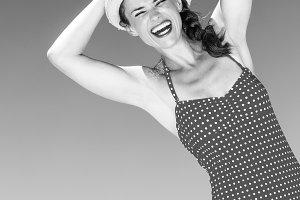 happy modern woman in swimsuit on seacoast