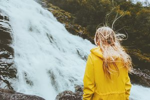 Woman looking at waterfall Traveling