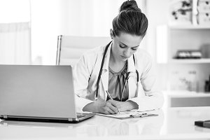 Doctor woman working in office