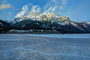 Frozen Lake with Rocky Mountains