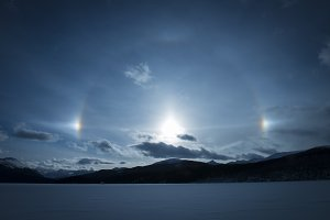 Sun Dogs over Winter Landscape