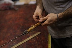 Blacksmith makes leather winding