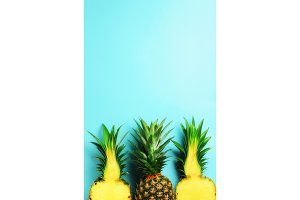 Pattern with bright pineapples on blue background. Top View. Copy Space. Minimal style. Pop art design, creative summer concept.
