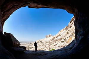 Man in the desert cave