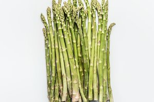 Green asparagus bunch on white