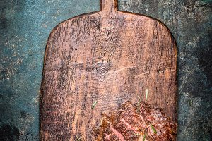 Wooden cutting board with steak