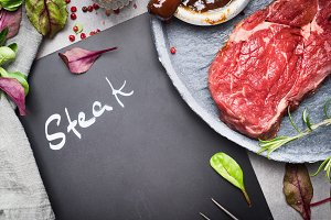 Chalkboard and raw beef steak