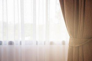 Sunlight through the white curtain