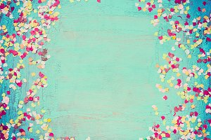 Party confetti on turquoise, frame
