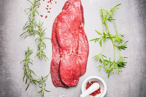 Raw beef meat steak with fresh herbs