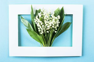 Lilies of the valley in a frame
