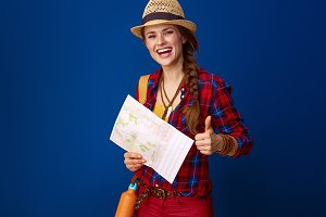 woman hiker against blue background with map showing thumbs up