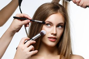 beautiful girl getting hair and makeup