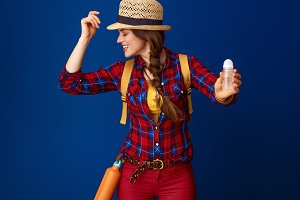 traveller woman against blue background showing antiperspirant