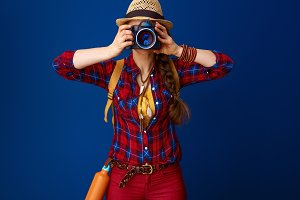 adventure traveller woman taking photo with digital camera