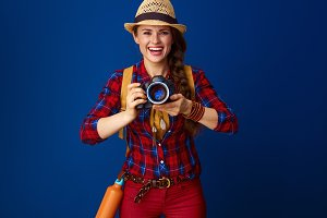 happy healthy traveller woman with modern DSLR camera